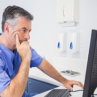 dentist at computer